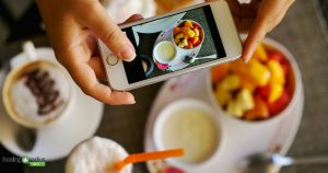 Wellness bloggers taking picture of healthy meal