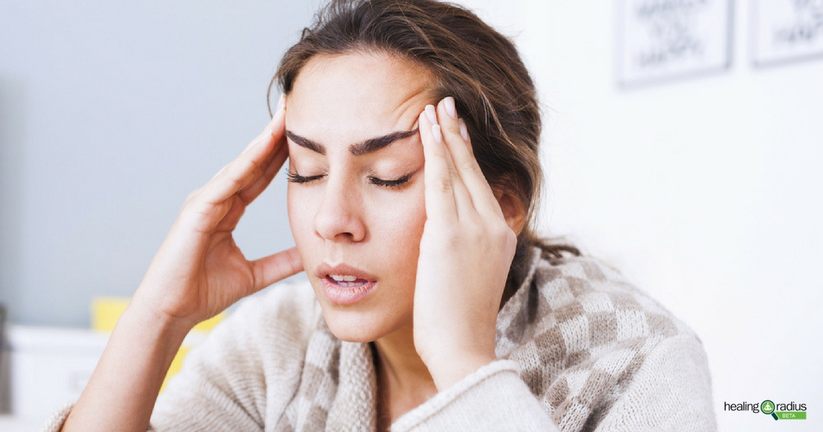 Woman uses pressure point to help relieve her headache