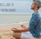 man on beach in meditation pose