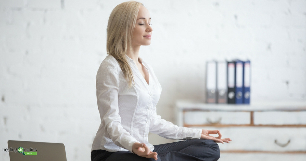 Easy yoga poses a business woman can do at work