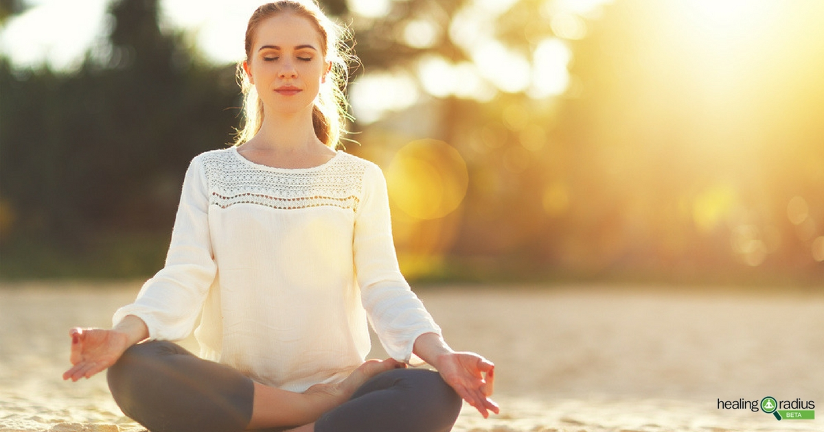 Young woman using yoga as natural remedies for anxiety
