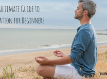 man on beach in meditation pose