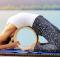 woman uses yoga wheel